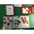 She had a go at writing the word for each colour name.