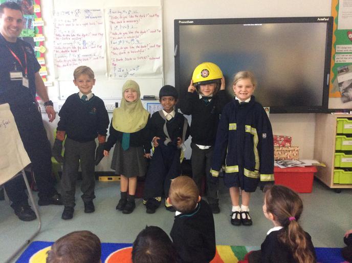 Zeph disappeared under the firefighter's helmet!