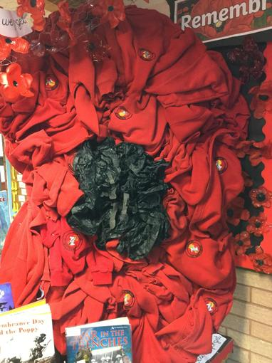 We used unwearable school uniform to create large scale poppies.