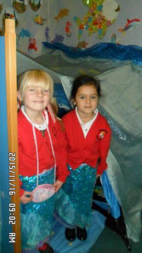 Jasmin and Emilia dressing up as mermaids.