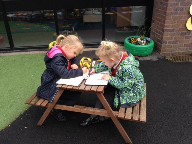 Rosa and Lily writing a story