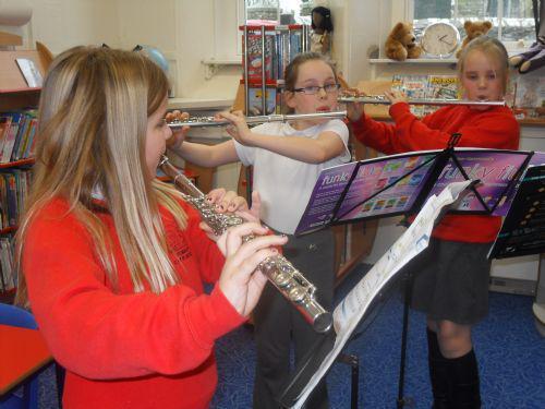 Practising their flutes