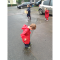 I am having fun jumping in the puddles!