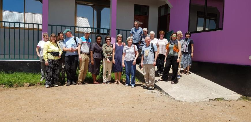 Our group photo outside the school