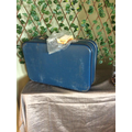 A mysterious suitcase was left in Class 3. Who does it belong to?