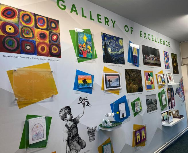 Excellent work by the children is displayed alongside some masterpieces studied