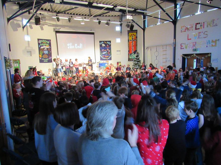 The whole school stands for a song and dance