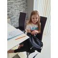 Esme is feeling carefully in the bag!