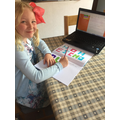 Charlotte working hard on her area homework!