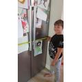 Sam sizing up the fridge.