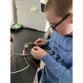 Harry's making a circuit.