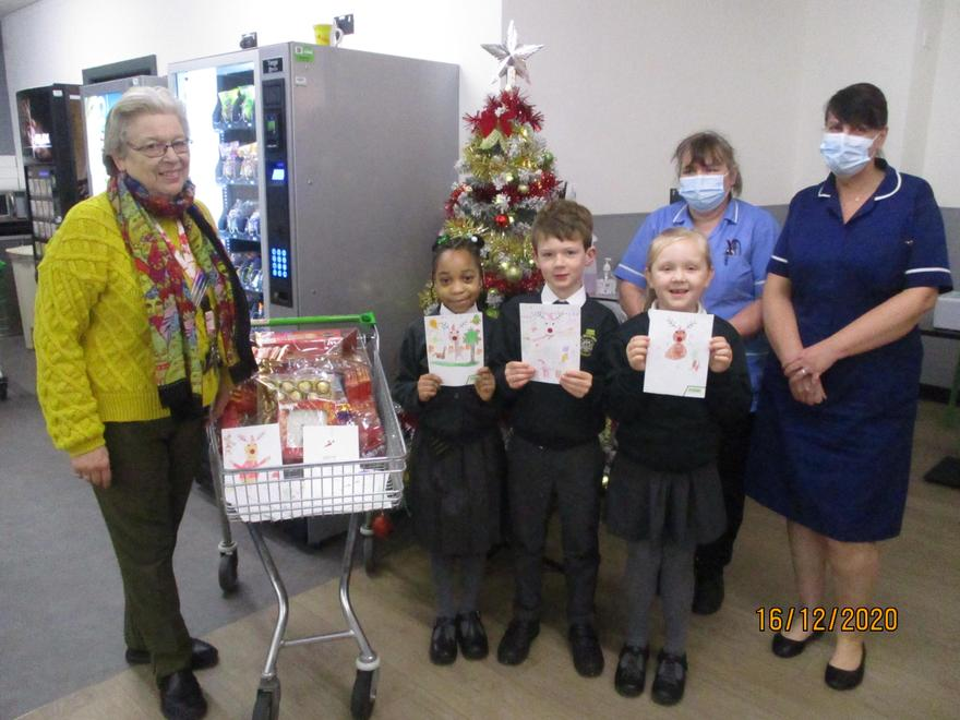 Children in Year 2 designed Christmas cards for residents of a local care home.