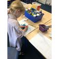 Kiki painting rocks