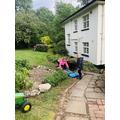 Ava helps in the garden