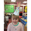 Esther has made an Easter bunny hat.