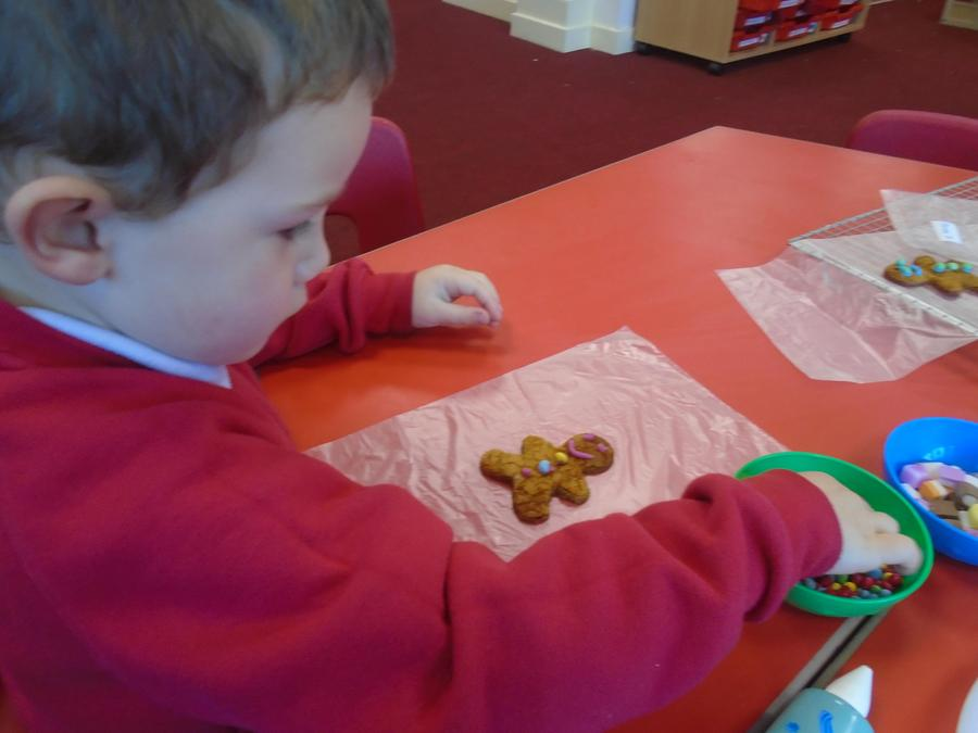 Decorating our gingerbread men