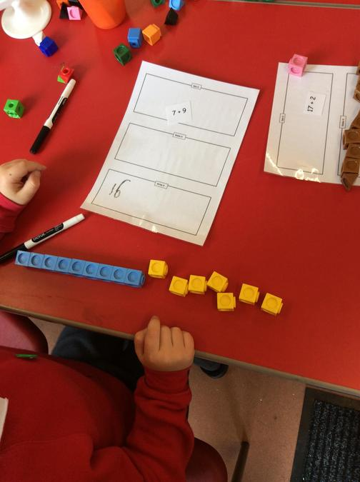 Carrying out simple addition using cubes