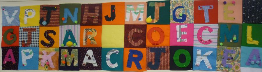 Initial letters sewn by the children.