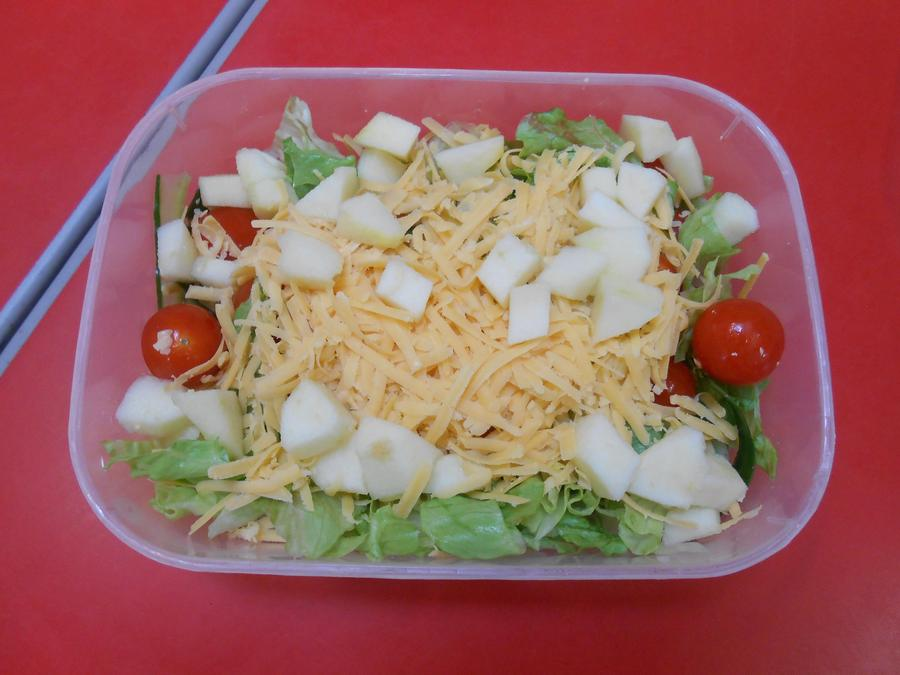 Lettuce, tomatoes, cucumber, cheese and apple