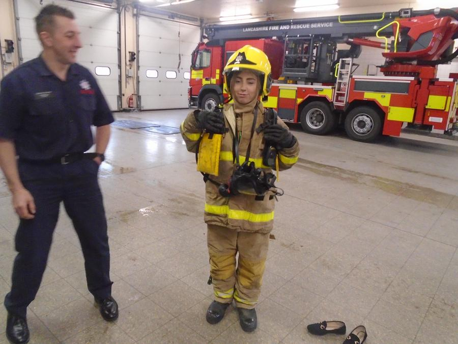Miss Martin dressed up as a firefighter