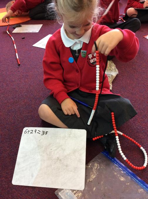 Using the beadstrings to help with addition