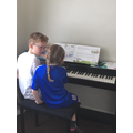 Learning the piano.