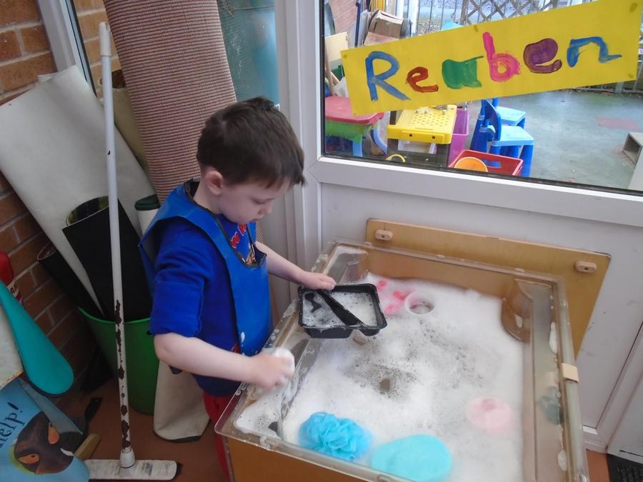 Indoor water play, with sponges and flannels