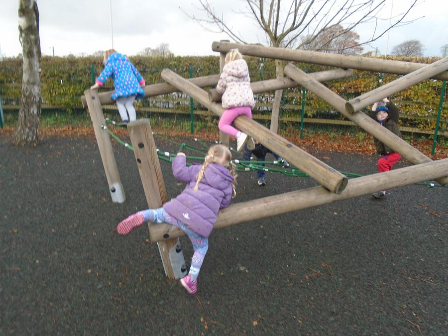 Climbing on the outdoor climbing frame