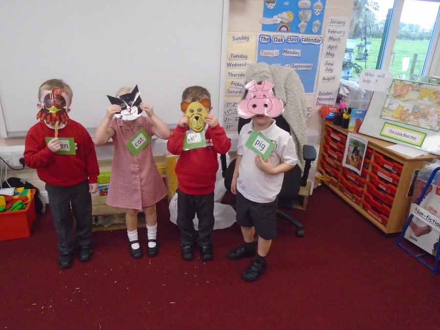 """Acting out the story of """"The Little Red Hen"""""""