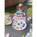 Painting eggs for an Easter egg hunt