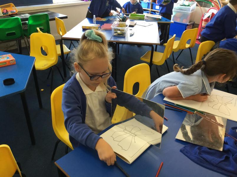 Exploring symmetry in maths