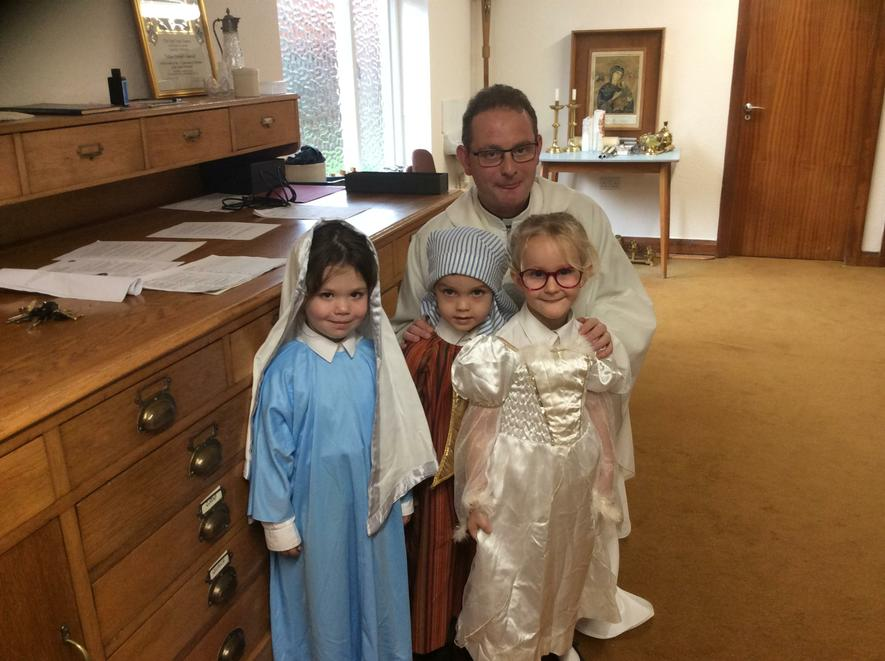 Mary, Joseph and Angel Gabriel with Father Kieren