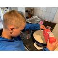 Jayden in Y3 measuring flour for cupcakes