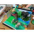 Rainforest model using toy animals by Archie EYFS