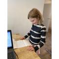 Writing a letter to Grandma, Maddie Y3