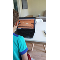 Oscar (Y2) completing some English on a laptop