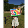Rainbow painting by Margot in EYFS