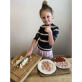 Maddie in Year 3 preparing a meal for the family