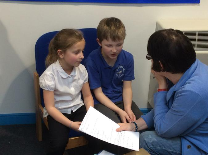 Pupils from Hedgehog class talking to a Governor