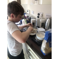 Olly baking fairy cakes!