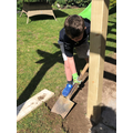Isaac helping in the garden
