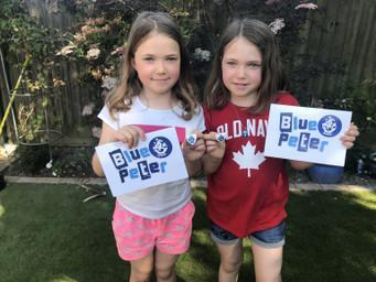 Ella & Josie receiving Blue Peter badges for poems
