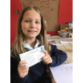 Lottie received her postcard from school