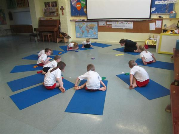 Charlie helps the kids relax with yoga