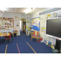 Chestnut carpet space and Smart Interactive Board.