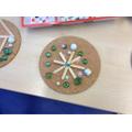 Snowflake design using loose parts.