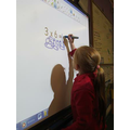 Using the Smartboard to work out 3 x 6 = ?