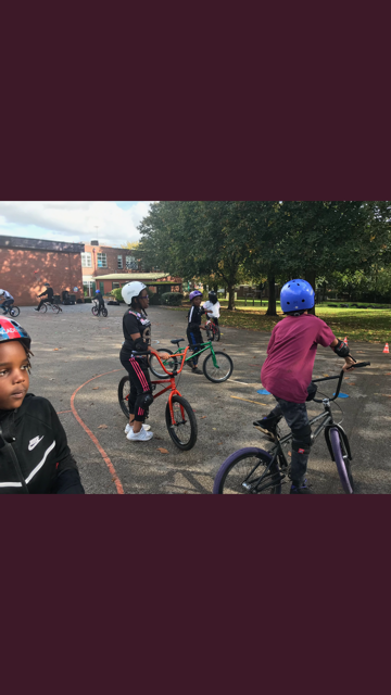 Year 5 learning new tricks on a BMX.