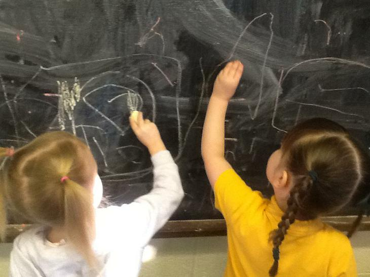 Mark making on the chalkboard.