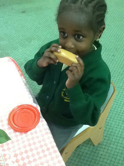 Talia enjoying her hotdog.